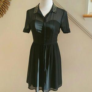 "Dress by ""Laura Conrad"""